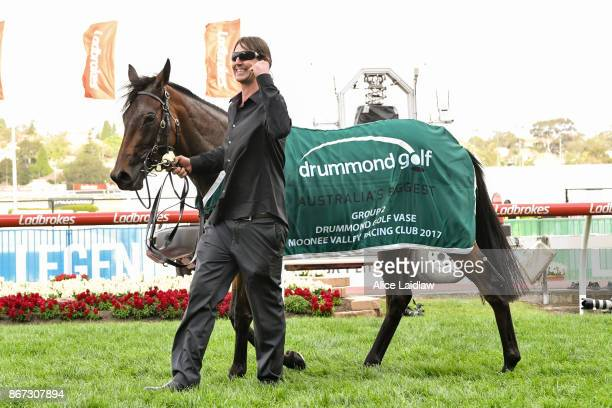 Aloisia with strapper Malcolm Benson after winning the Drummond Golf Vase at Moonee Valley Racecourse on October 28 2017 in Moonee Ponds Australia
