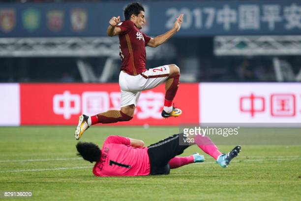 Aloisio of Hebei China Fortune jumps over Yan Junling of Shanghai SIPG during the 21st round match of 2017 China Super League between Hebei China...