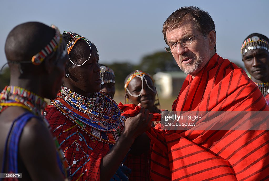 Alojz Peterle, head of the European Union Election Observation Mission (EU EOM) in Kenya is pictured in Maasai dress, after it was presented to him as a present in Kiserian, outside Nairobi on February 28, 2013. Kenya is preparing for national elections on March 4, 2013 and the European Union has sent observers to report on the process and outcome. AFP PHOTO/Carl de Souza