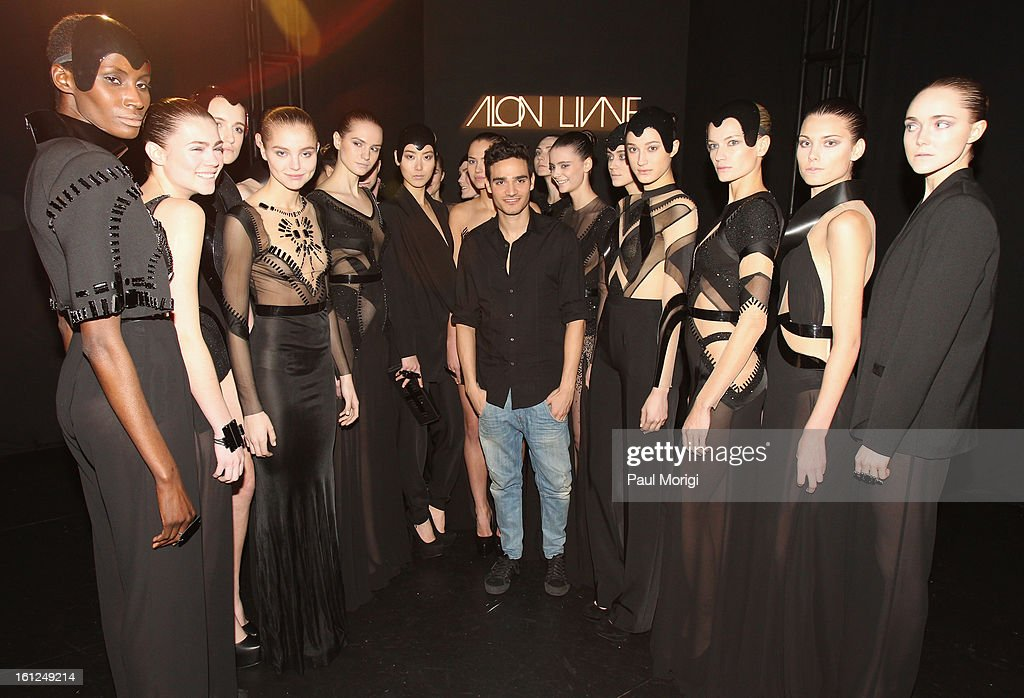 Alon Livne (center) attends the Alon Livne Fall 2013 fashion show during Mercedes-Benz Fashion Week at The Box at Lincoln Center on February 9, 2013 in New York City.