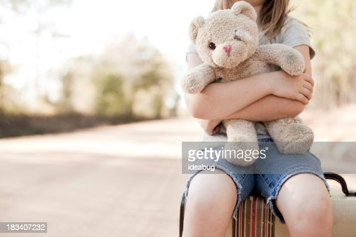 'Alone Young Girl Hugging Old, Raggedy Teddy Bear'