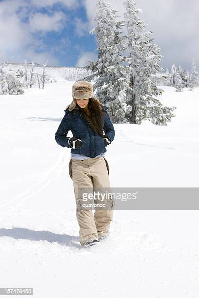 Alone Young Woman Walking on Snow Covered Mountain, Copy Space