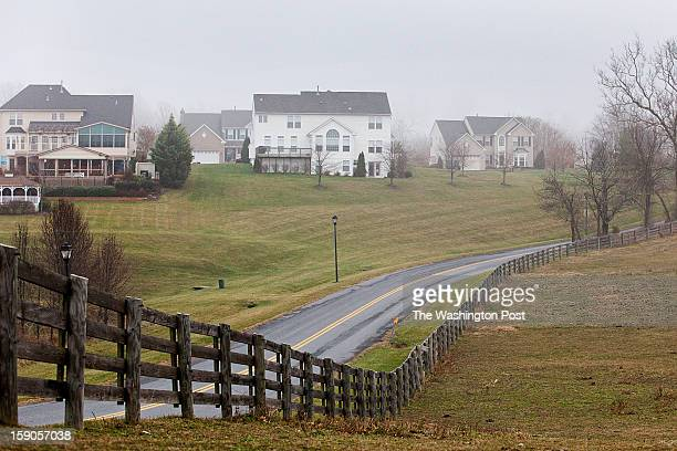 Along Kings Valley Road homes from the Westview Estates community are seen at left and land from Kings Valley Farm is seen at right in Damascus...