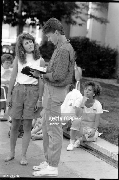 Along the 16 st mall Wednesday Todd 01thoff and Cheryl Monziardini18 use drama to evangelize to passersby in back is Diana Robinson listening all are...