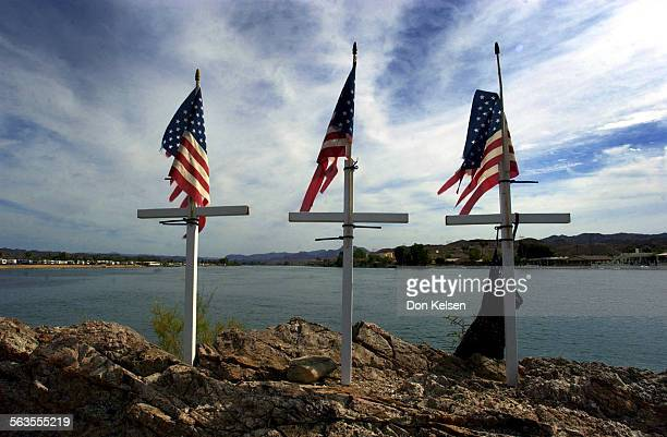 Along the Parker Strip at Bass Point three crosses mark the spot on the Colorado River where an accident killed three boaters early one morning of...
