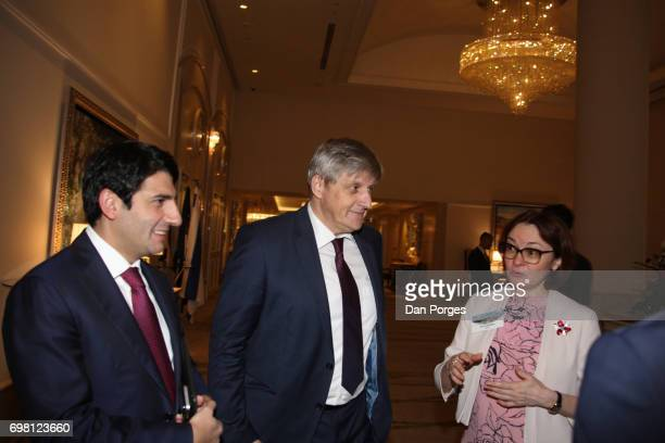 Along with an unidentified man Governor of the Central Bank of Bosnia and Herzegovina Senad Softic and Head of the Central Bank of Russia Elvira...