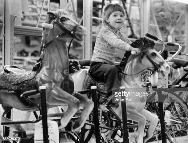 Alongside this year's Electronic and spaceage toys some things don't Change Above Natalie Pyle age 2 takes toy horse for test ride at Lionel...