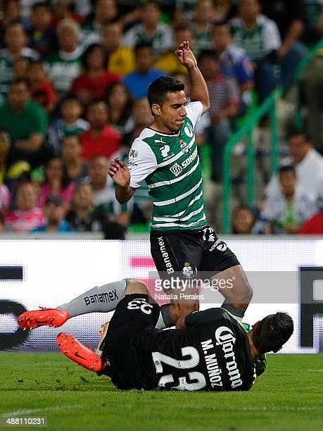 Alonso Escoboza of Santos tries to score a goal against Goalkeeper Moises Munoz during the Quarterfinal second leg match between Santos Laguna and...