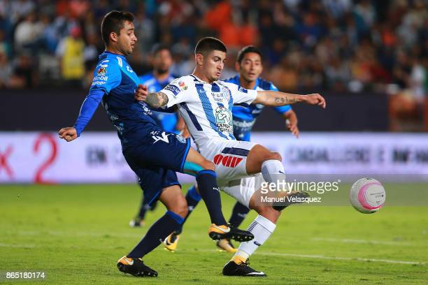 Alonso Zamora of Puebla figths for the ball with Victor Guzman of Pachuca during the 14th round match between Pachuca and Puebla as part of the...