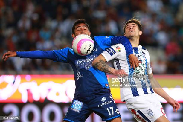 Alonso Zamora of Puebla struggles for the ball with Angelo Sagal of Pachuca during the 14th round match between Pachuca and Puebla as part of the...