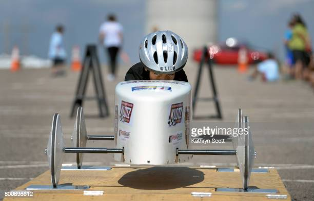 Alonzo Campos sits in his car on the scales to test the weight for the stock division of racing Kids and their families participate in the 11th...