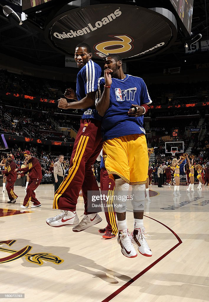 Alonzo Gee #33 and Kyrie Irving #2 of the Cleveland Cavaliers greet each other during starting lineup introductions prior to the game against the Milwaukee Bucks at The Quicken Loans Arena on January 25, 2013 in Cleveland, Ohio.