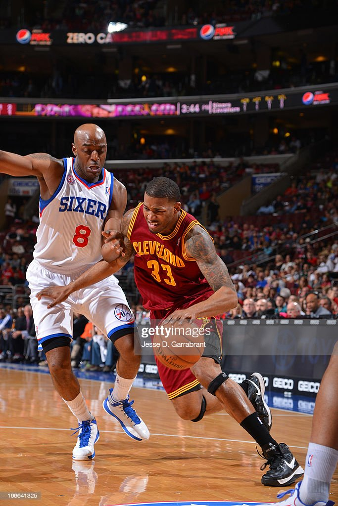 Alonzo Gee #33 of the Cleveland Cavaliers drives against Damien Wilkins #8 of the Philadelphia 76ers at the Wells Fargo Center on April 14, 2013 in Philadelphia, Pennsylvania.