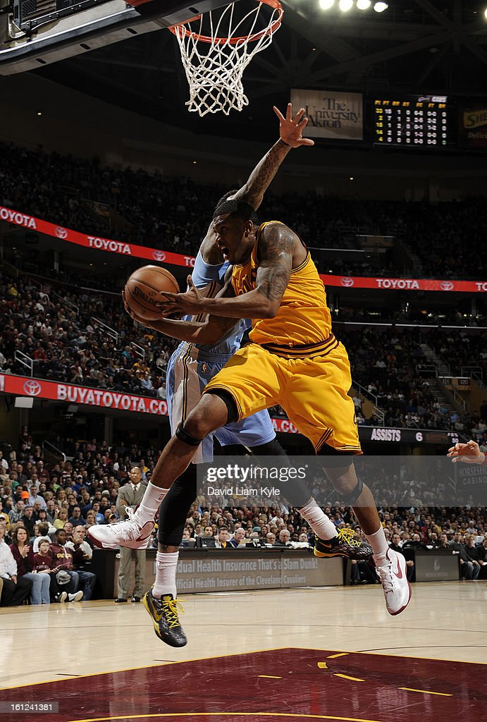 Alonzo Gee #33 of the Cleveland Cavaliers drives in for the shot against Wilson Chandler #21 of the Denver Nuggets at The Quicken Loans Arena on February 9, 2013 in Cleveland, Ohio.