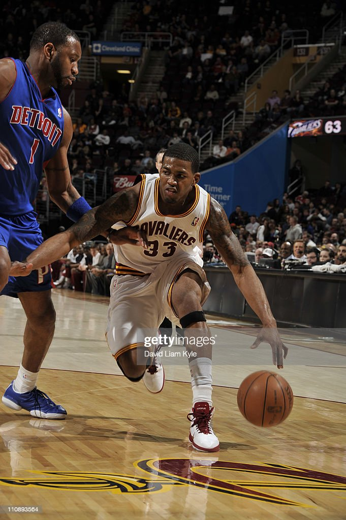 Alonzo Gee #33 of the Cleveland Cavaliers drives to the basket against <a gi-track='captionPersonalityLinkClicked' href=/galleries/search?phrase=Tracy+McGrady&family=editorial&specificpeople=201486 ng-click='$event.stopPropagation()'>Tracy McGrady</a> #1 of the Detroit Pistons during the game at The Quicken Loans Arena on March 25, 2011 in Cleveland, Ohio.