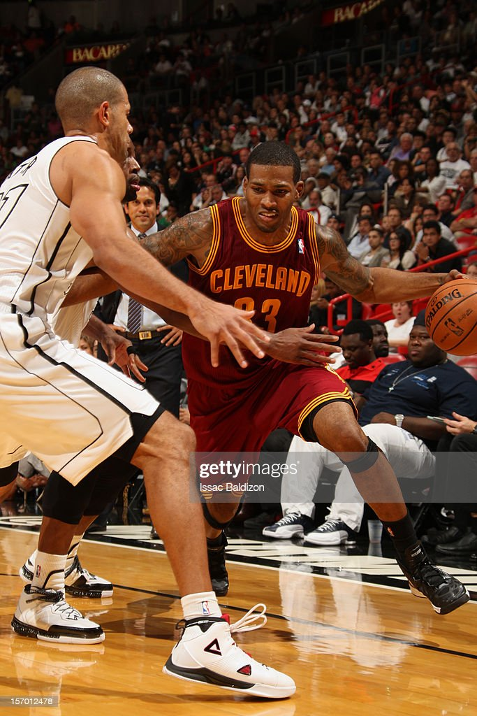 <a gi-track='captionPersonalityLinkClicked' href=/galleries/search?phrase=Alonzo+Gee&family=editorial&specificpeople=801443 ng-click='$event.stopPropagation()'>Alonzo Gee</a> #33 of the Cleveland Cavaliers drives to the basket against <a gi-track='captionPersonalityLinkClicked' href=/galleries/search?phrase=Shane+Battier&family=editorial&specificpeople=201814 ng-click='$event.stopPropagation()'>Shane Battier</a> #31 of the Miami Heat on November 24, 2012 at American Airlines Arena in Miami, Florida.
