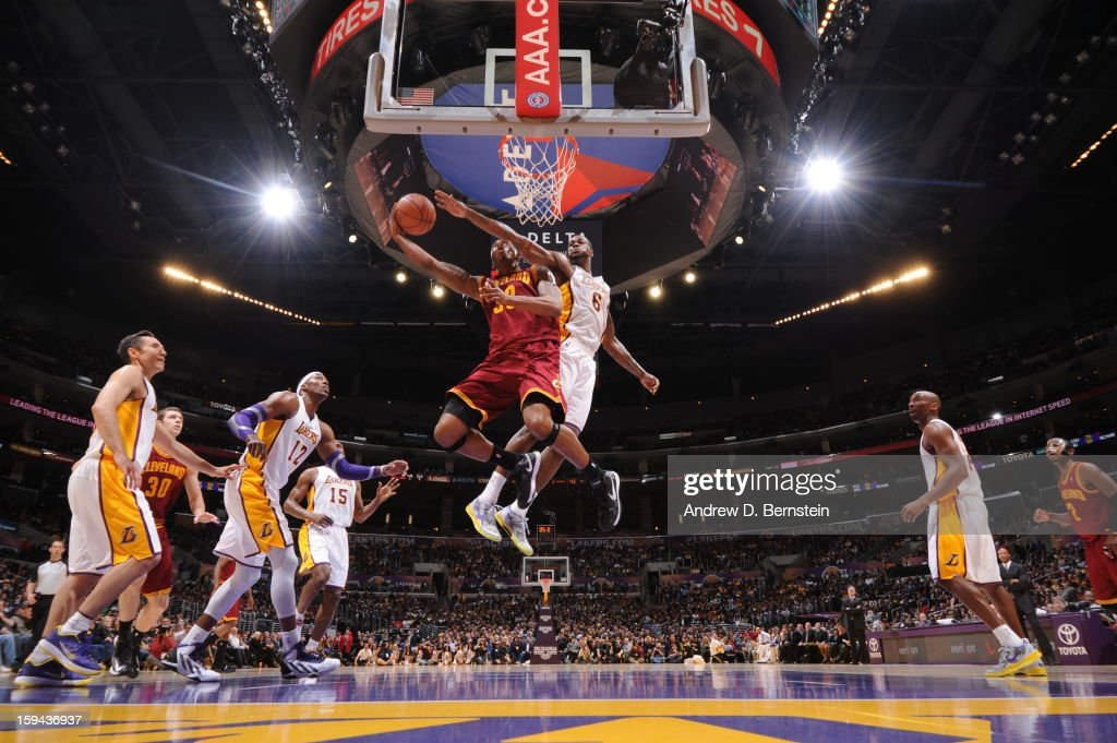 Alonzo Gee #33 of the Cleveland Cavaliers drives to the basket against Earl Clark #6 of the Los Angeles Lakers at Staples Center on January 13, 2013 in Los Angeles, California.