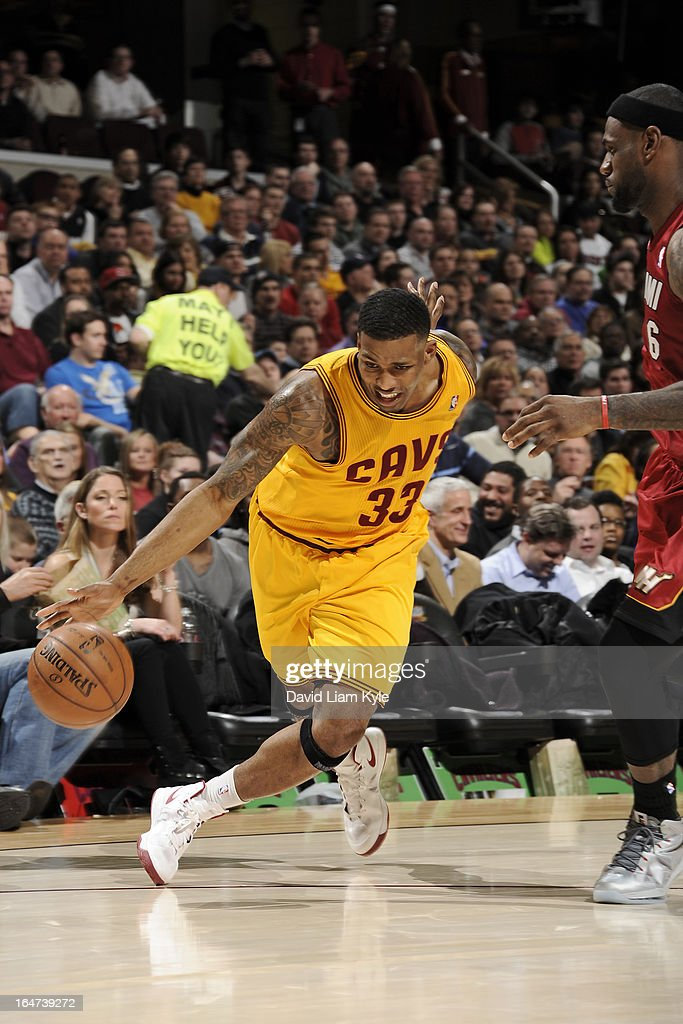 Alonzo Gee #33 of the Cleveland Cavaliers drives to the basket against the Miami Heat at The Quicken Loans Arena on March 20, 2013 in Cleveland, Ohio.