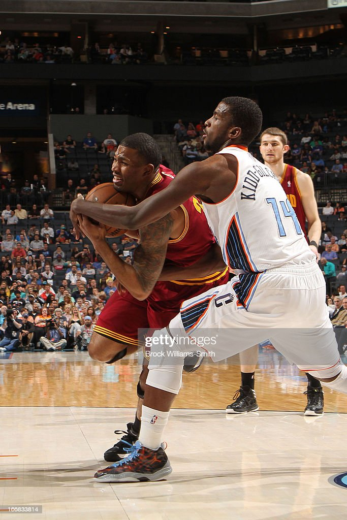 Alonzo Gee #33 of the Cleveland Cavaliers drives to the basket against Michael Kidd-Gilchrist #14 of the Charlotte Bobcats at the Time Warner Cable Arena on April 17, 2013 in Charlotte, North Carolina.