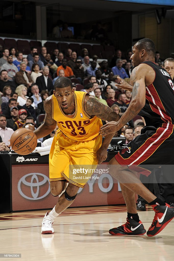 <a gi-track='captionPersonalityLinkClicked' href=/galleries/search?phrase=Alonzo+Gee&family=editorial&specificpeople=801443 ng-click='$event.stopPropagation()'>Alonzo Gee</a> #33 of the Cleveland Cavaliers drives to the basket against <a gi-track='captionPersonalityLinkClicked' href=/galleries/search?phrase=Rashard+Lewis&family=editorial&specificpeople=201713 ng-click='$event.stopPropagation()'>Rashard Lewis</a> #9 of the Miami Heat at The Quicken Loans Arena on April 15, 2013 in Cleveland, Ohio.