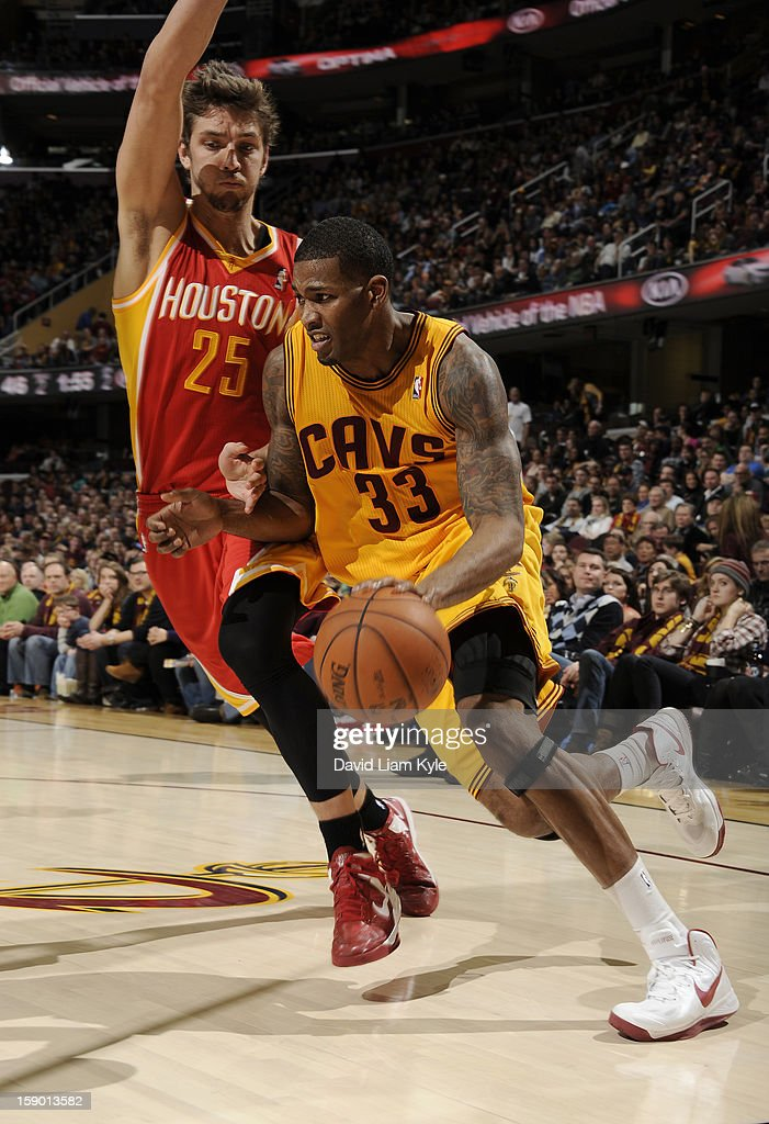 <a gi-track='captionPersonalityLinkClicked' href=/galleries/search?phrase=Alonzo+Gee&family=editorial&specificpeople=801443 ng-click='$event.stopPropagation()'>Alonzo Gee</a> #33 of the Cleveland Cavaliers drives to the hoop against <a gi-track='captionPersonalityLinkClicked' href=/galleries/search?phrase=Chandler+Parsons&family=editorial&specificpeople=4249869 ng-click='$event.stopPropagation()'>Chandler Parsons</a> #25 of the Houston Rockets at The Quicken Loans Arena on January 5, 2013 in Cleveland, Ohio.