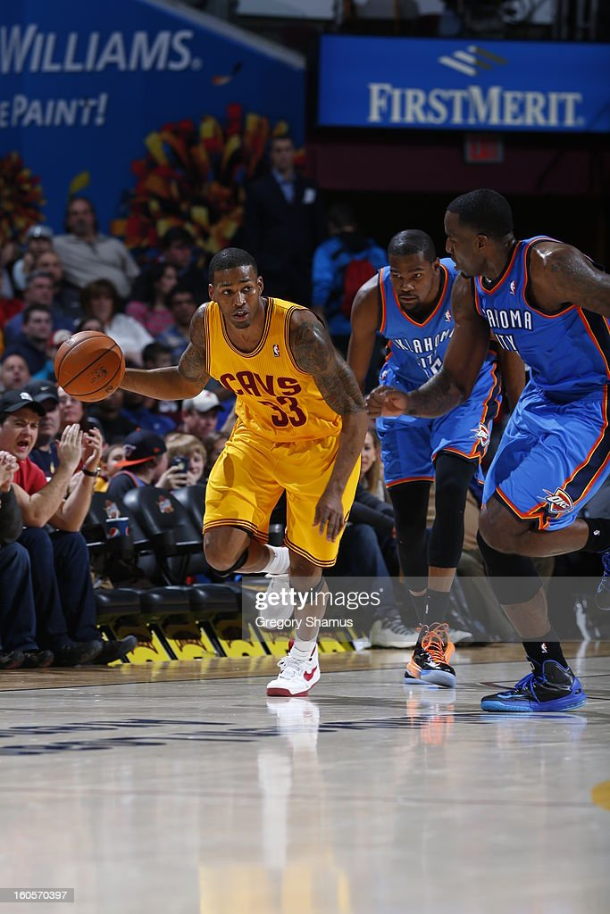Alonzo Gee #33 of the Cleveland Cavaliers drives up-court against Kevin Durant #35 and Kendrick Perkins #5 of the Oklahoma City Thunder at The Quicken Loans Arena on February 2, 2013 in Cleveland, Ohio.