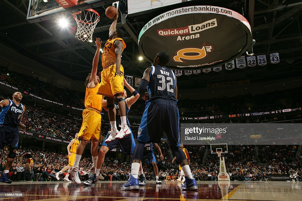 <a gi-track='captionPersonalityLinkClicked' href=/galleries/search?phrase=Alonzo+Gee&family=editorial&specificpeople=801443 ng-click='$event.stopPropagation()'>Alonzo Gee</a> #33 of the Cleveland Cavaliers dunks the ball against <a gi-track='captionPersonalityLinkClicked' href=/galleries/search?phrase=O.J.+Mayo&family=editorial&specificpeople=2351505 ng-click='$event.stopPropagation()'>O.J. Mayo</a> #32 of the Dallas Mavericks at The Quicken Loans Arena on November 17, 2012 in Cleveland, Ohio.