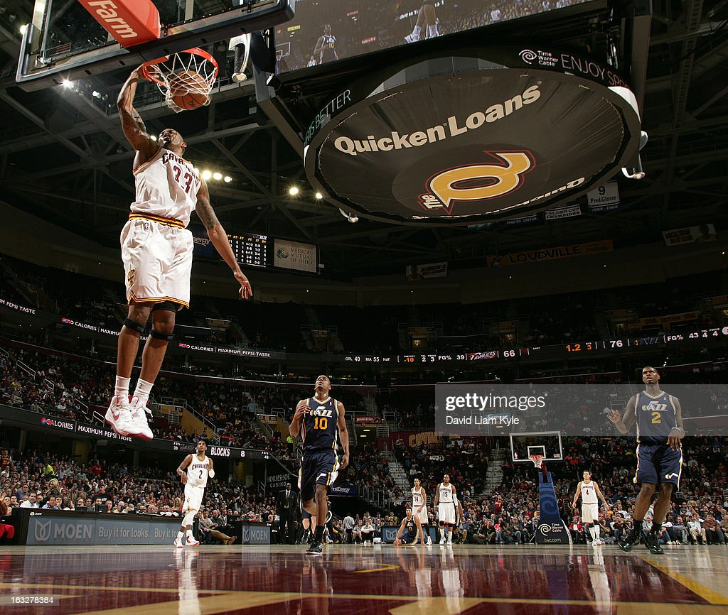 Alonzo Gee #33 of the Cleveland Cavaliers dunks the fast break trailed by Alec Burks #10 of the Utah Jazz at The Quicken Loans Arena on March 6, 2013 in Cleveland, Ohio.