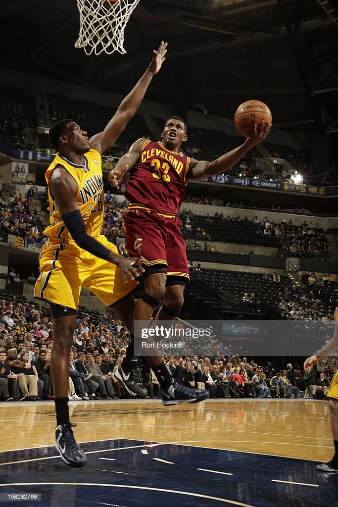 Alonzo Gee #33 of the Cleveland Cavaliers goes to the basket against Ian Mahinmi #28 of the Indiana Pacers during the game between the Indiana Pacers and the Cleveland Cavaliers on December 12, 2012 at Bankers Life Fieldhouse in Indianapolis, Indiana.
