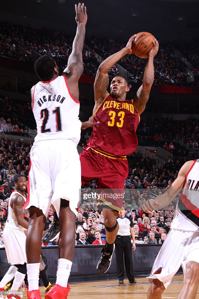 Alonzo Gee #33 of the Cleveland Cavaliers goes to the basket against J.J. Hickson #21 of the Portland Trail Blazers on January 16, 2013 at the Rose Garden Arena in Portland, Oregon.