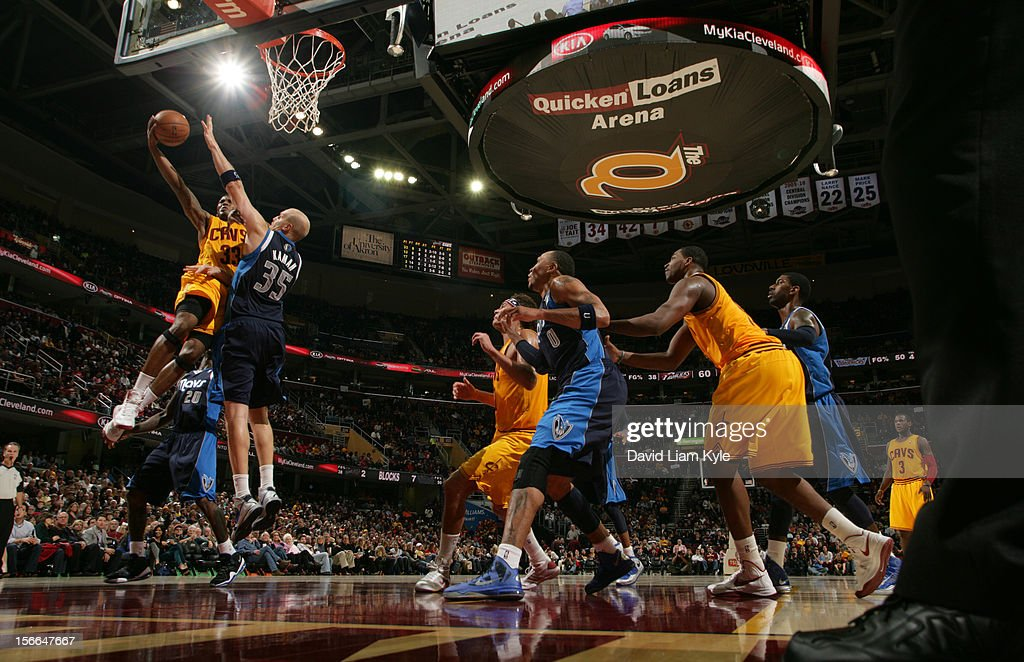 <a gi-track='captionPersonalityLinkClicked' href=/galleries/search?phrase=Alonzo+Gee&family=editorial&specificpeople=801443 ng-click='$event.stopPropagation()'>Alonzo Gee</a> #33 of the Cleveland Cavaliers goes up for the shot against <a gi-track='captionPersonalityLinkClicked' href=/galleries/search?phrase=Chris+Kaman&family=editorial&specificpeople=201661 ng-click='$event.stopPropagation()'>Chris Kaman</a> #35 of the Dallas Mavericks at The Quicken Loans Arena on November 17, 2012 in Cleveland, Ohio.