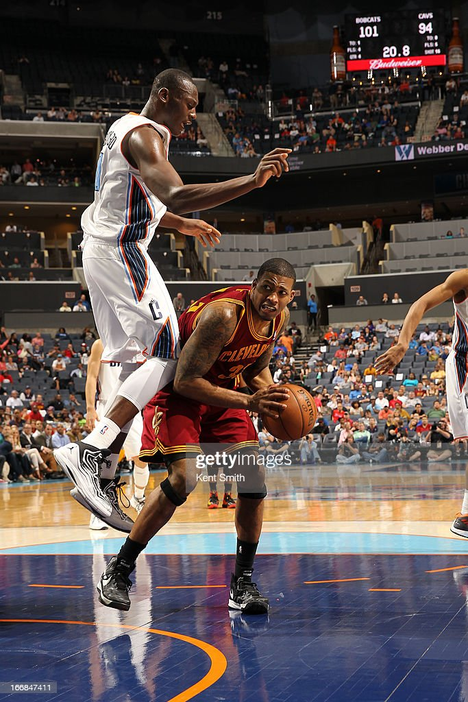 Alonzo Gee #33 of the Cleveland Cavaliers looks to shoot the ball against Bismack Biyombo #0 of the Charlotte Bobcats at the Time Warner Cable Arena on April 17, 2013 in Charlotte, North Carolina.