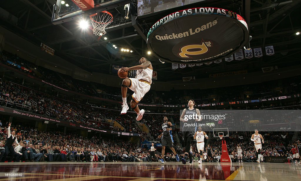 Alonzo Gee #33 of the Cleveland Cavaliers rises for a dunk trailed by Josh McRoberts #17 of the Orlando Magic at The Quicken Loans Arena on February 8, 2013 in Cleveland, Ohio.