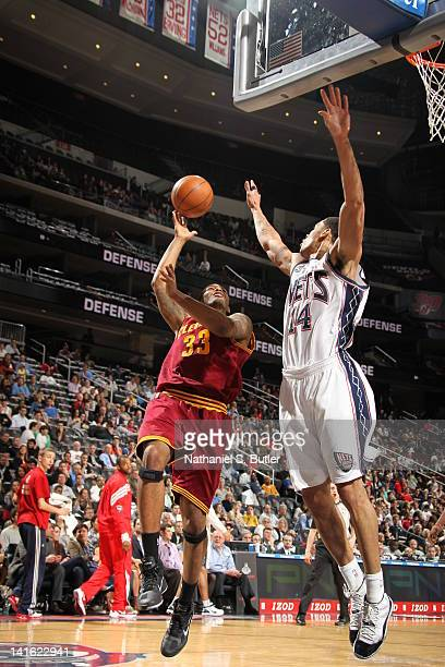 Alonzo Gee of the Cleveland Cavaliers shoots against Gerald Green of the New Jersey Nets during the game on March 19 2012 at the Prudential Center in...