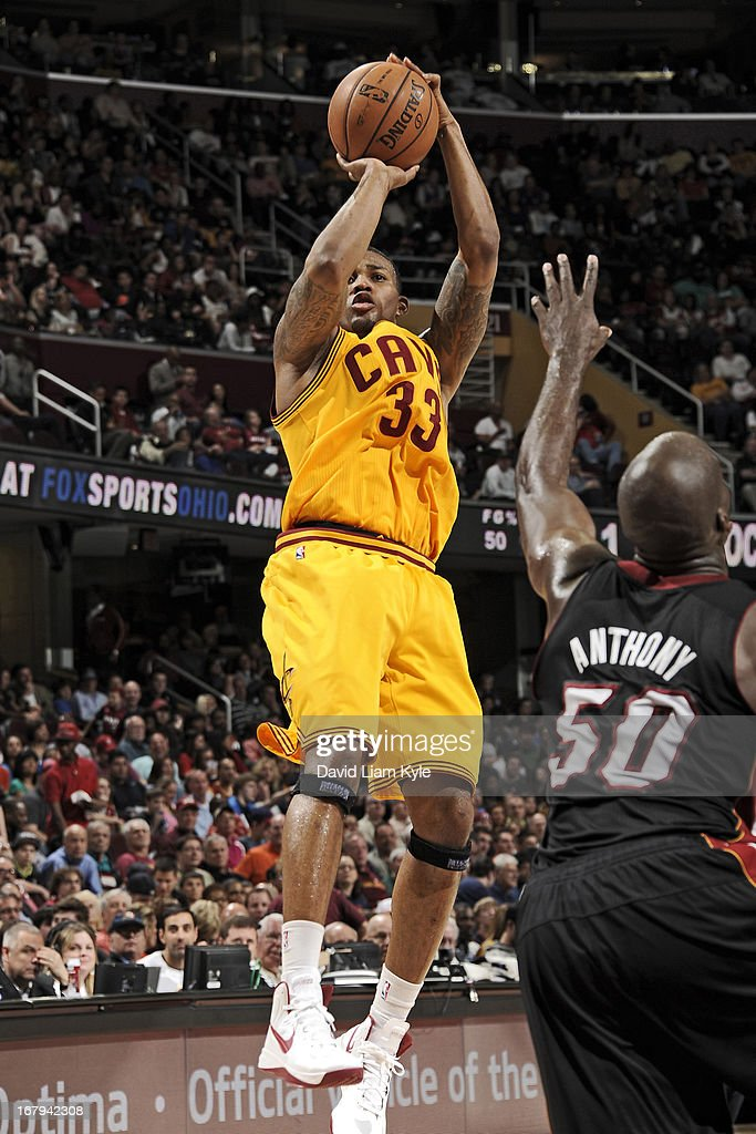 <a gi-track='captionPersonalityLinkClicked' href=/galleries/search?phrase=Alonzo+Gee&family=editorial&specificpeople=801443 ng-click='$event.stopPropagation()'>Alonzo Gee</a> #33 of the Cleveland Cavaliers shoots against <a gi-track='captionPersonalityLinkClicked' href=/galleries/search?phrase=Joel+Anthony&family=editorial&specificpeople=4092295 ng-click='$event.stopPropagation()'>Joel Anthony</a> #50 of the Miami Heat at The Quicken Loans Arena on April 15, 2013 in Cleveland, Ohio.