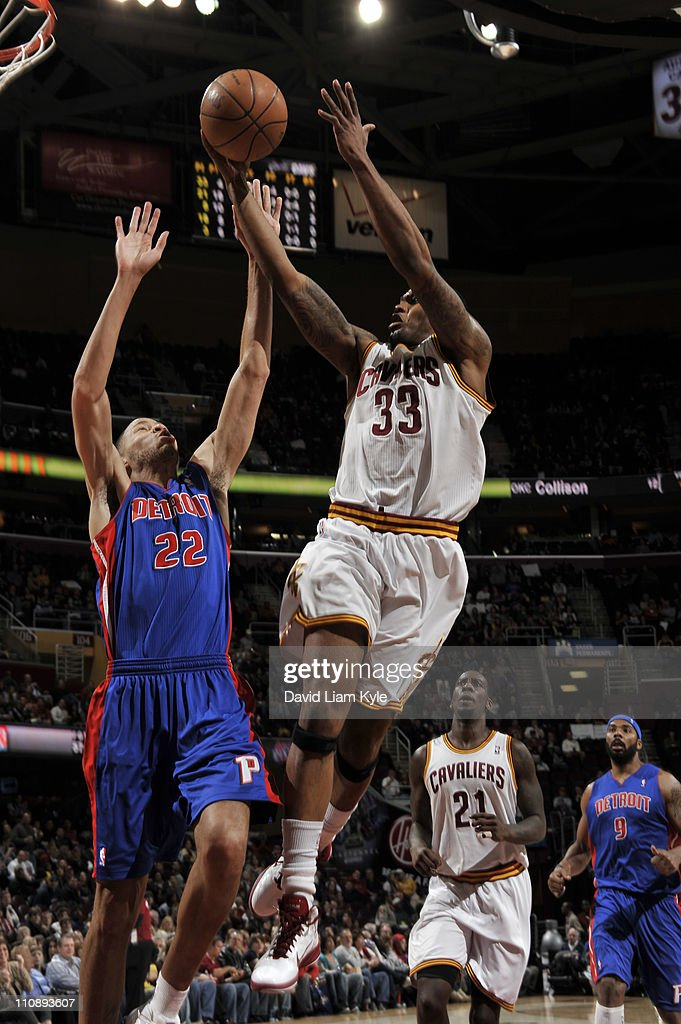 Alonzo Gee #33 of the Cleveland Cavaliers shoots against Tayshaun Prince #22 of the Detroit Pistons during the game at The Quicken Loans Arena on March 25, 2011 in Cleveland, Ohio.