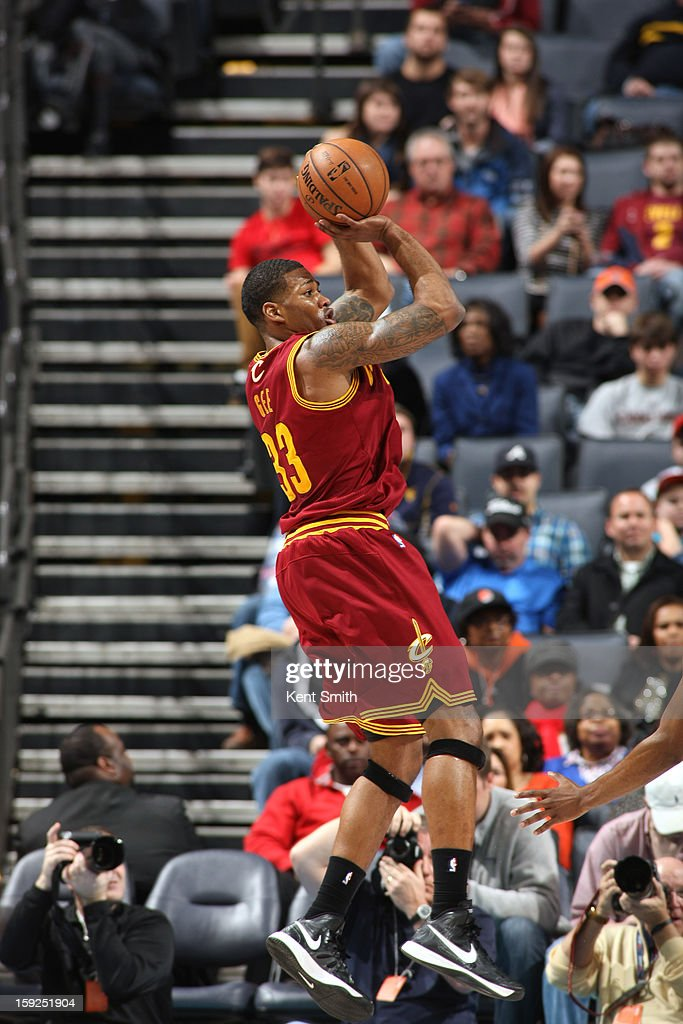 <a gi-track='captionPersonalityLinkClicked' href=/galleries/search?phrase=Alonzo+Gee&family=editorial&specificpeople=801443 ng-click='$event.stopPropagation()'>Alonzo Gee</a> #33 of the Cleveland Cavaliers takes a shot against the Charlotte Bobcats at the Time Warner Cable Arena on January 4, 2013 in Charlotte, North Carolina.