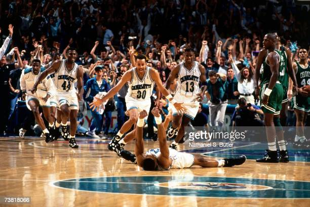 Alonzo Mourning and the Charlotte Hornets celebrate after winning game four of round one of the 1993 NBA Playoffs against the Boston Celtics in...