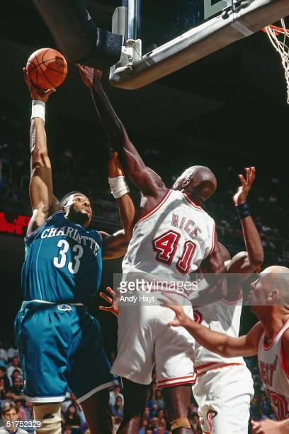 Alonzo Mourning of the Charlotte Hornets takes a hook shot against the Miami Heat during the NBA game on November 27 1993 in Miami Florida NOTE TO...