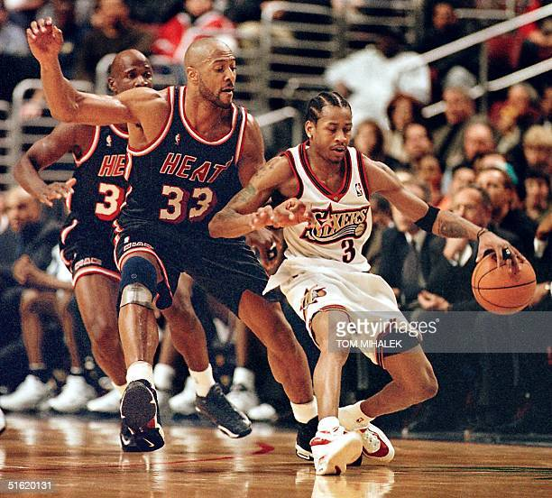 Alonzo Mourning of the Miami Heat defends against the Philadelphia 76ers Allen Iverson 05 March in Philadelphia Miami won 8978 AFP PHOTO/TOM MIHALEK