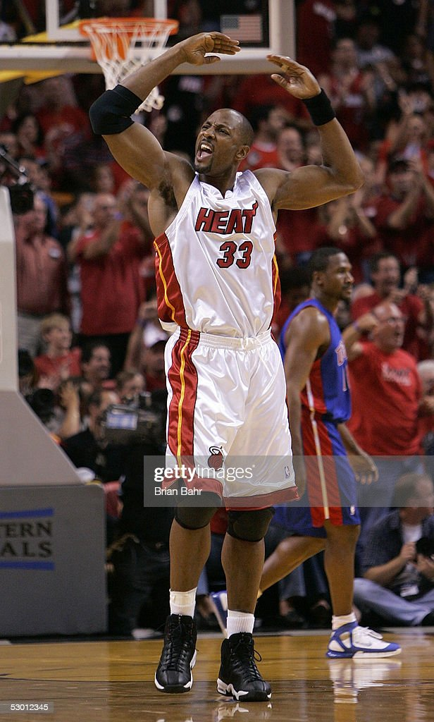 Alonzo Mourning of the Miami Heat fires up the fans as he celebrates against the Detroit Pistons in Game Five of the Eastern Conference Finals during...
