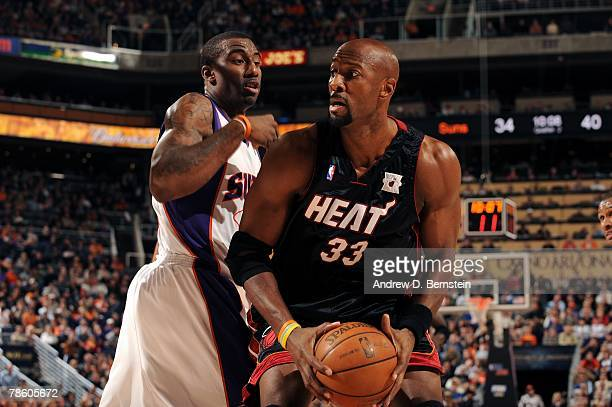 Alonzo Mourning of the Miami Heat is defended by Amare Stoudemire of the Phoenix Suns during the game on December 10 2007 at US Airways Center in...