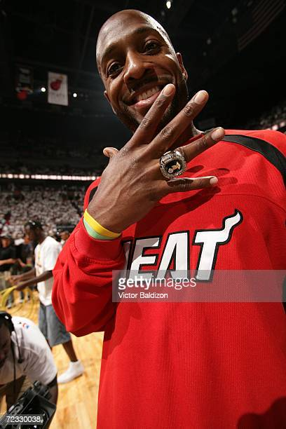 Alonzo Mourning of the Miami Heat shows off his 2006 NBA Championship Ring during the ring ceremony before the start of the Season Opener against the...