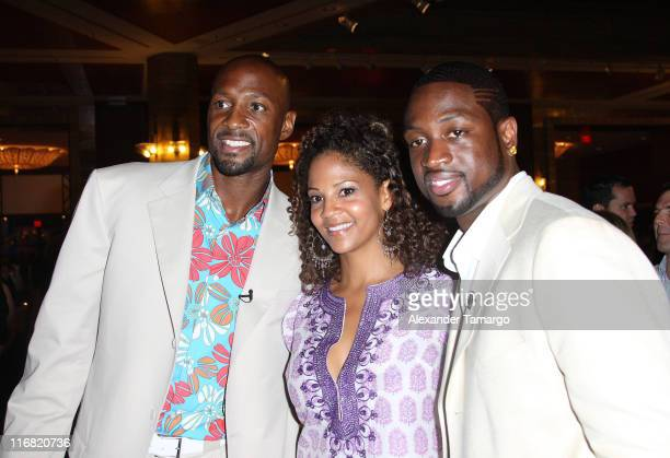 Alonzo Mourning Tracy Mourning and Dwyane Wade poses at Zo's Summer Groove Beach Ball at Hotel Intercontinental on July 11 2008 in Miami Florida