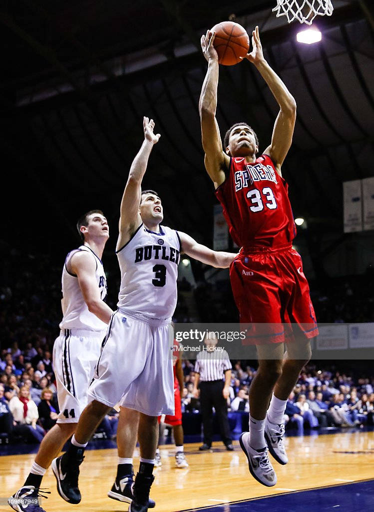 Alonzo Nelson-Ododa #33 of the Richmond Spiders shoots the ball as Alex Barlow #3 of the Butler Bulldogs defends from behind at Hinkle Fieldhouse on January 16, 2013 in Indianapolis, Indiana. Butler defeated Richmond 62-47.