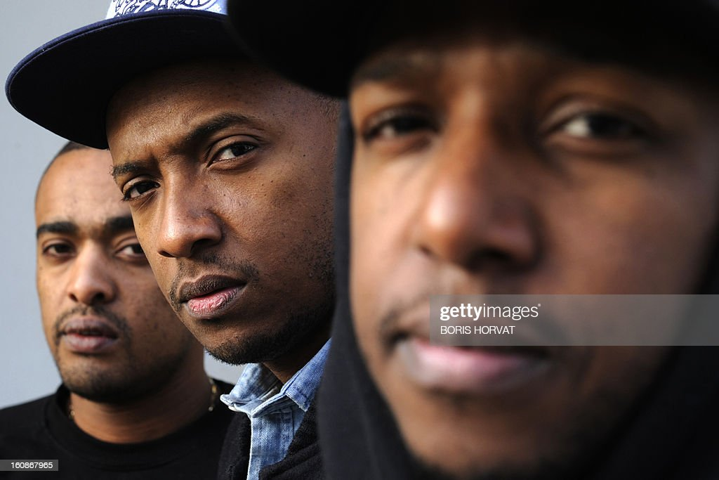 Alonzo, Soprano and Vincenzo of French rap band 'Psy4 de la rime' pose on February 6, 2013 at a recording studio in Marseille, southern France. 'Psy4 de la rime' rap band features Marseille police corruption scandal from late 2012, involving officers of the Anti Criminal Brigade (BAC) in northern Marseille, in its latest video clip entitled 'Crise de nerfs' (Nervous Breakdown), mixing TV culture and tpoical issues. Most of the officers who have been charged or suspended were arrested in early October 2012 following the discovery of cash and drugs hidden above a false ceiling in their office, and were suspected of routinely stealing drugs and cash from dealers and of holding on to cigarettes confiscated from illicit sellers.