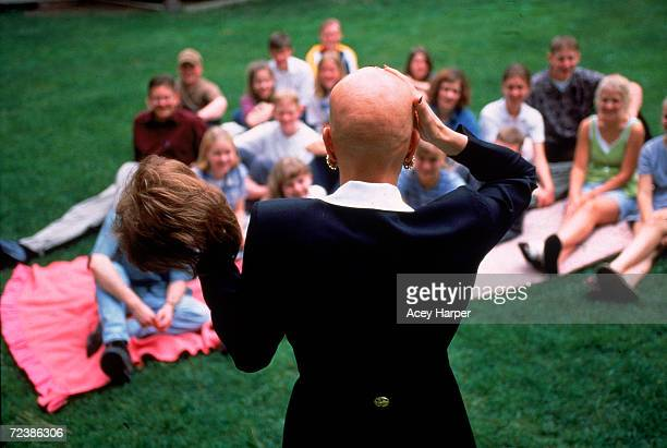 Alopecia sufferer beauty queen Cari Bickley showing off her bald head while talking to a group of young people and holding her wig in Spokane...