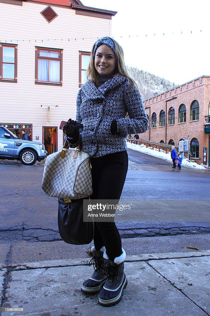Alora Alexander, publicist from Narrative Group from Los Angeles, wearing BDG coat, J Brand jeans, Sorel boots, Louis Vuitton monogram bag, and Marc Jacobs black leather bag on January 17, 2013 on the streets of Park City, Utah.