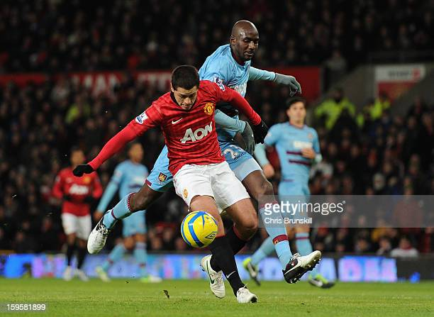 Alou Diarra of West Ham United tangles with Javier Hernandez of Manchester United during the FA Cup with Budweiser Third Round Replay match between...