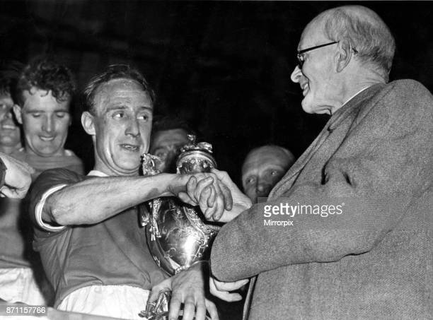 Aloysius McGowan the Wrexham captain receives the Welsh Cup from Mr EJ Morgan vicepresident of the Football Association of Wales at Ninian Park...